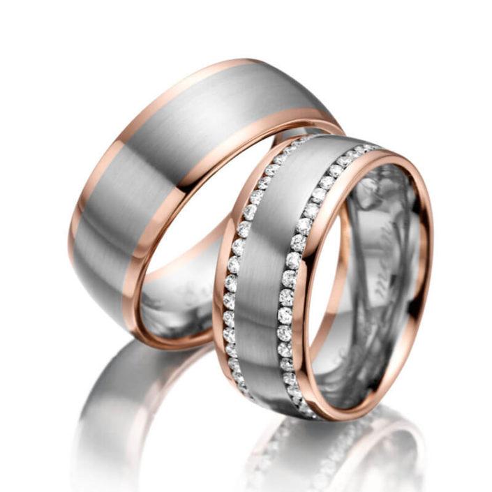 Trauringe aus Graugold/Rotgold mit 2 seitlichen Diamantkränzen