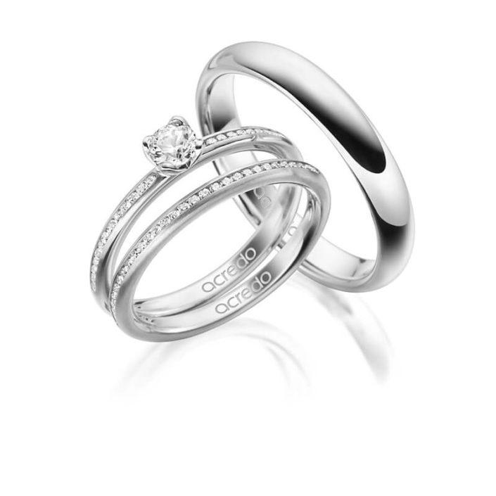Ringset aus 3 Ringen, Solitärring mit Kargenfassung, 2 Memoire-Ringe